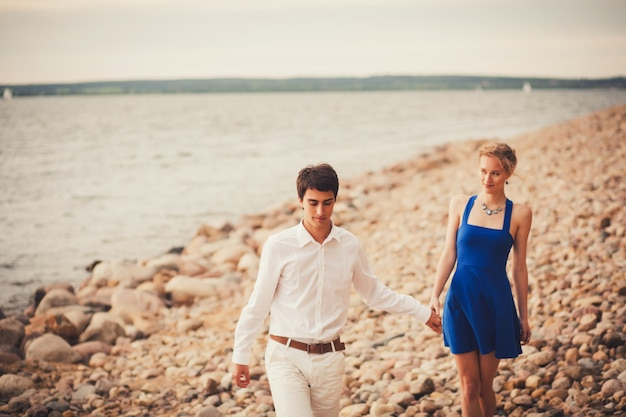 Vacation couple walking on beach together