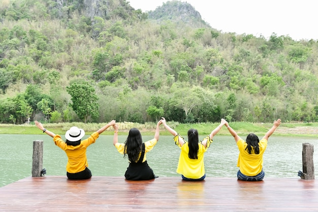 On vacation, four women go to travel to relax in nature.