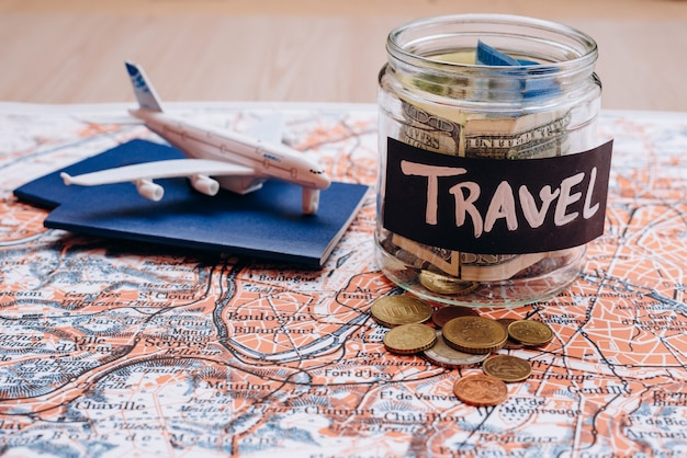 Vacation money savings in a glass jar with travel text