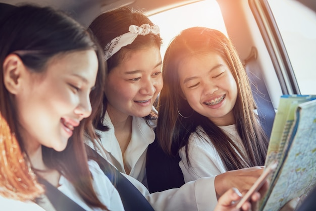 Vacation time, three beautiful young women cheerful travels together