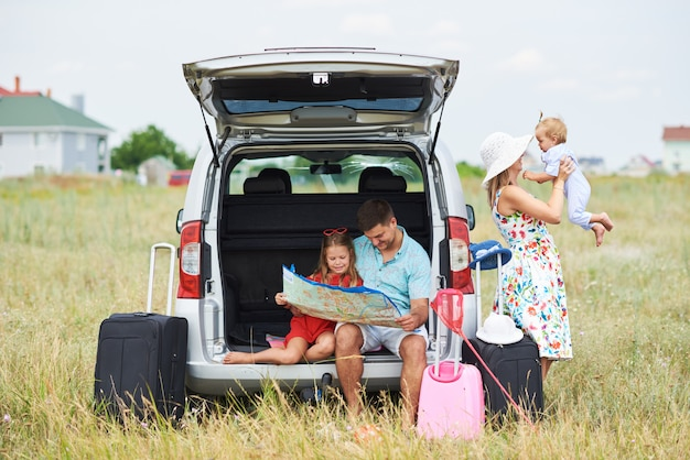 Vacation, travel - happy family ready for the travel for summer vacation. people have fun and take pictures on the phone. take a selfie on the memory of the journey