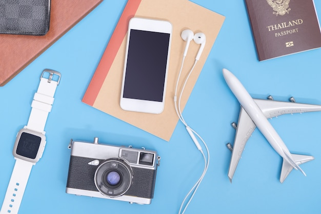 Vacation travel objects on soft blue background for travel concept