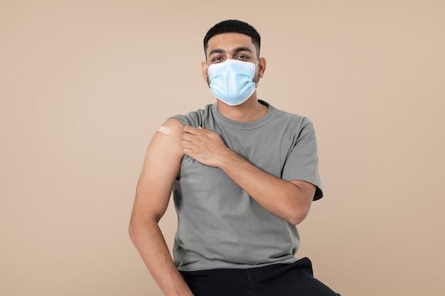 Vaccinated indian man presenting shoulder
