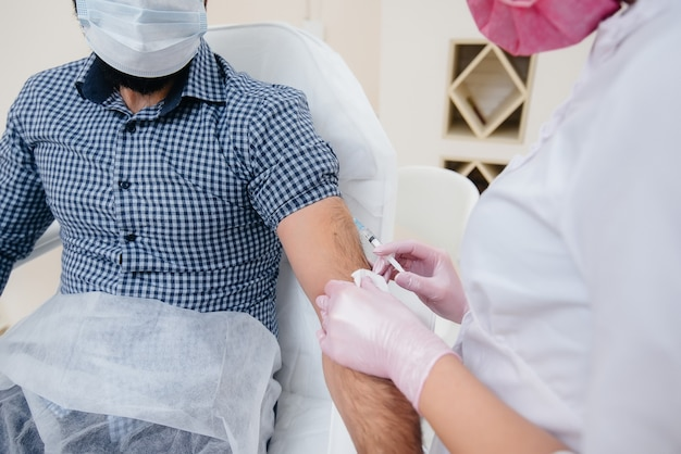 Vaccination of a man against flu and coronavirus infection during a worldwide pandemic.