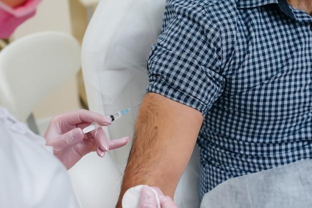 世界的大流行中のインフルエンザおよびコロナウイルス感染に対する男性のワクチン接種