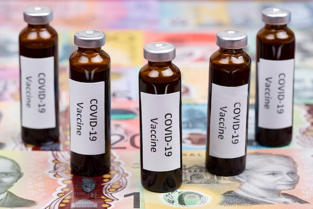 Vaccine against covid on the background of australian money