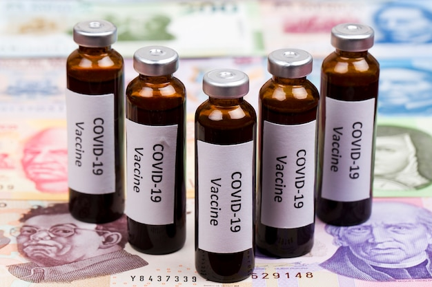 Vaccine against covid on the background of mexican money