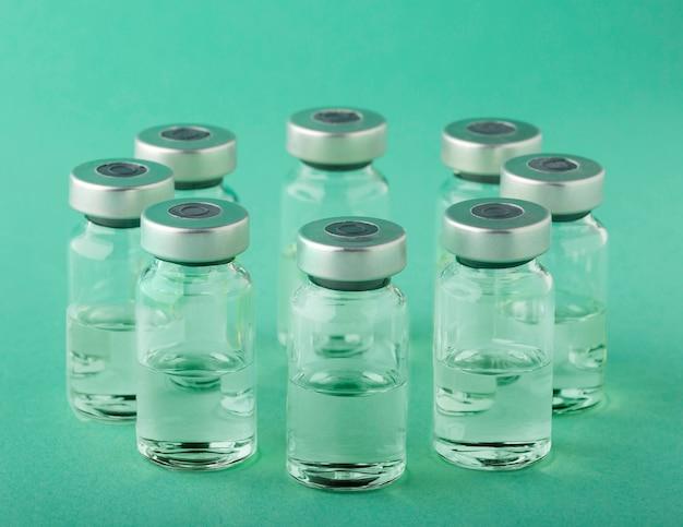 Vaccine bottle arrangement on green