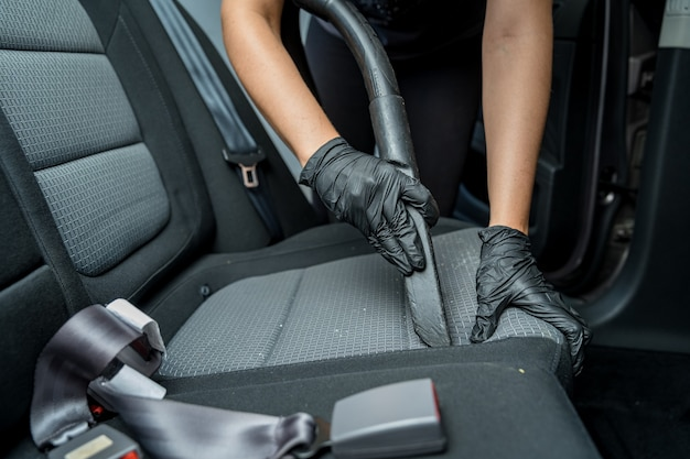 Vacuuming the vehicle interior during manual car cleaning