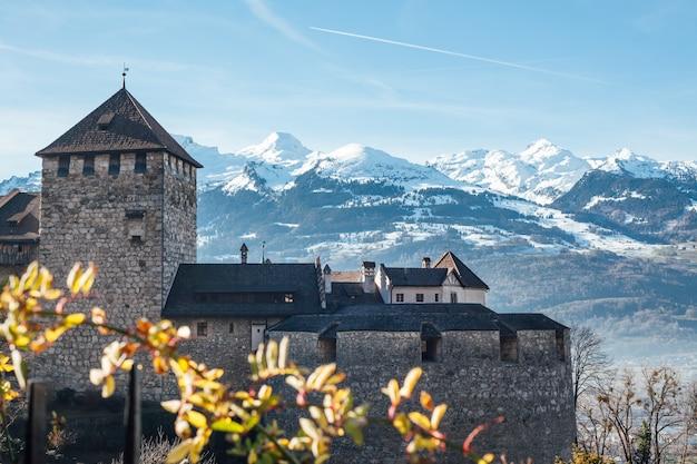 Vaduz castle on snow mountains