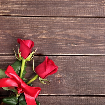 Valentine background of  red roses on wood