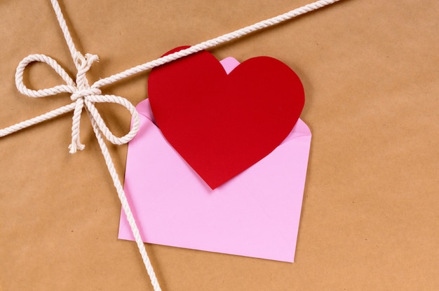 Valentine card on a brown paper package or gift tied with string.