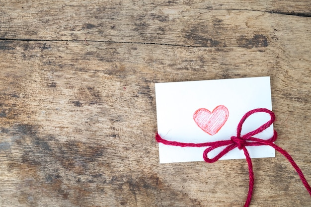 Valentine card with hand drawn red heart and red rope