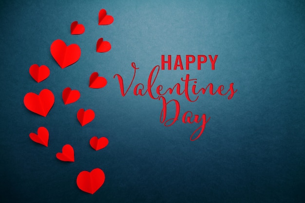 Valentine card with red heart on blue
