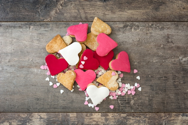 Valentine cookies with heart shape on wooden surface