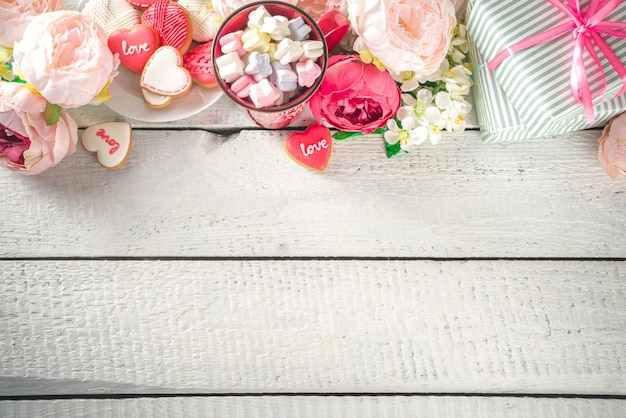 Valentine day background with peony flowers and hot chocolate