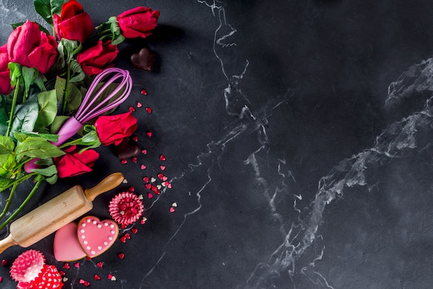 Valentine day baking background with roses and baking tools