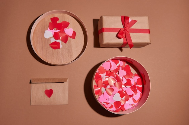 Valentine day composition.present or gift box red hearts. envelope postcard with confetti