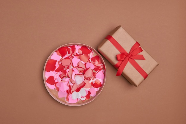 Valentine day composition with copy space.present or gift box  with ribbon bow and red hearts.