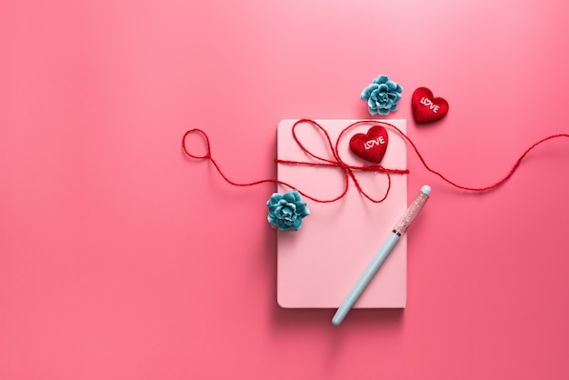 Valentine day concept, love daily with red hearts on pink background