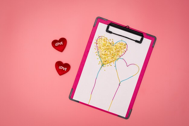 Valentine day concept, white note with red hearts on pink background
