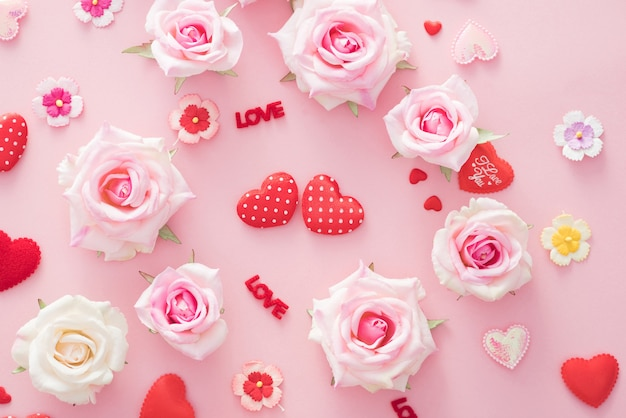 Valentine day gift box with red hearts and roses on pink backgro