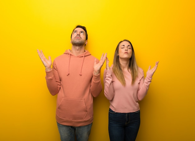 In valentine day group of two people on yellow background frustrated by a bad situation