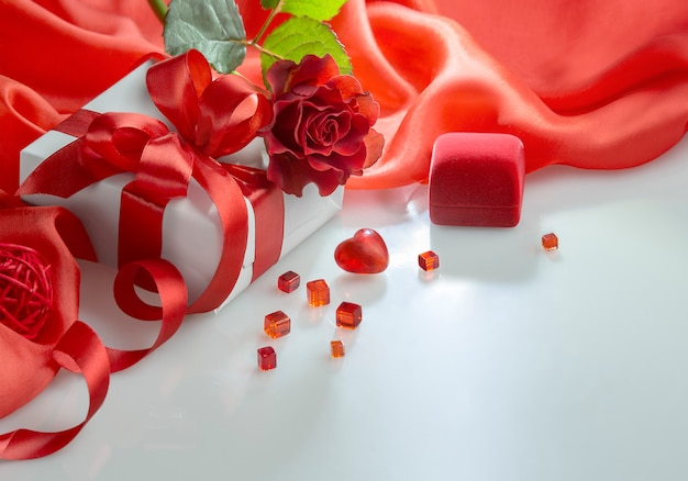 Valentine day heart, roses bouquet and gift boxes on white