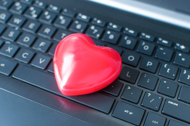 Valentine day online shopping. laptop, red heart.
