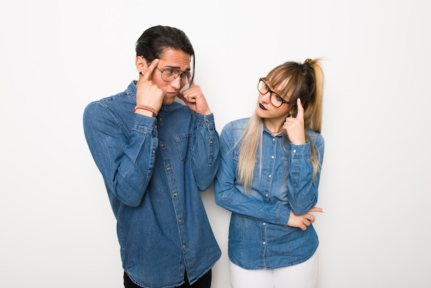 In valentine day young couple with glasses having doubts and thinking