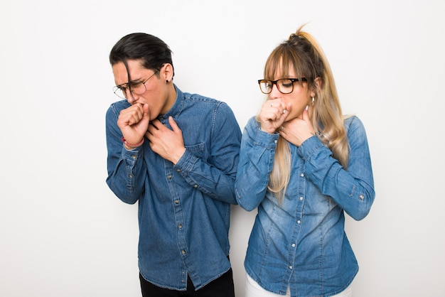 In valentine day young couple with glasses is suffering with cough and feeling bad