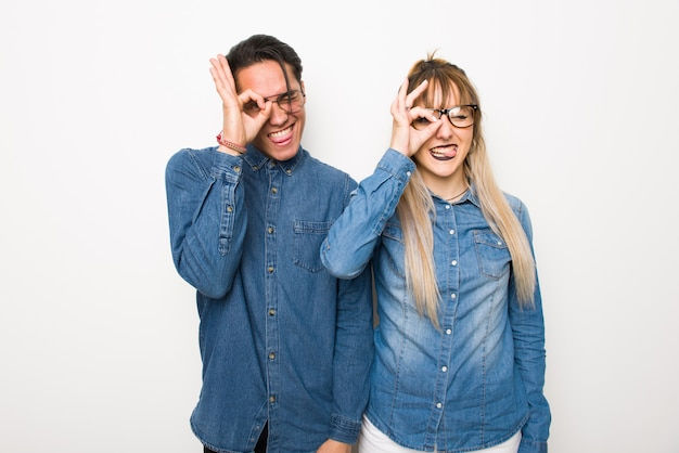 In valentine day young couple with glasses makes funny and crazy face emotion