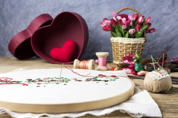 Valentine embroidery and equipment on wood table
