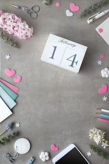 Valentine flat lay with pearl hyacinth flowers and calendar