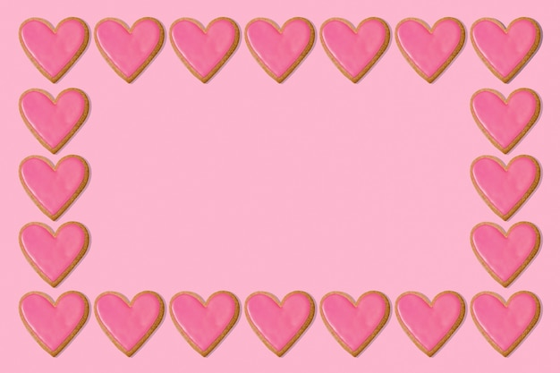 Valentine frame background. pink heart cookies. love concept. copy space