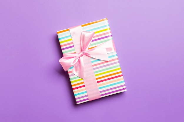 Valentine gift box on colored background