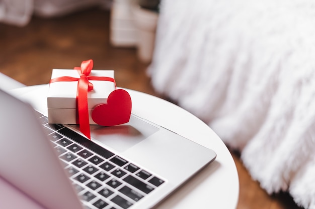 Valentine gift boxe on laptop, online shopping concept.
