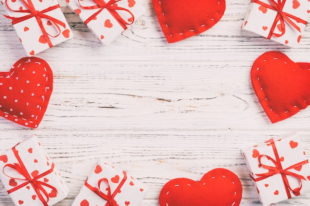 Valentine gift boxes on wooden background, copyspace