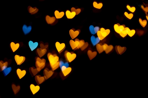 Valentine grunge heart shaped lights background yellow gold and blue heartshaped