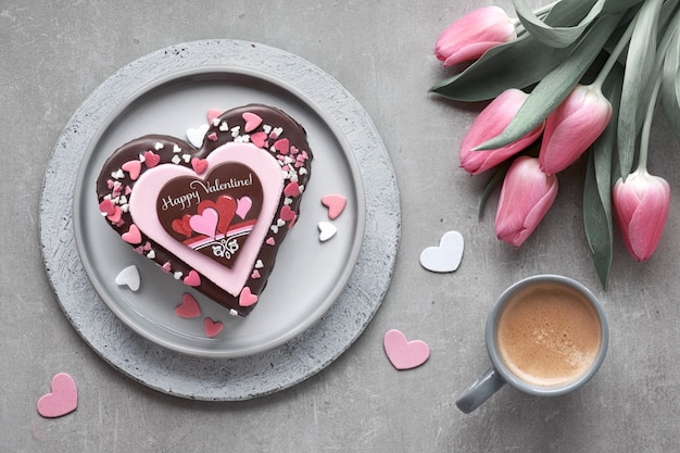 Valentine heart cake with chocolate, sugar decorations and greet