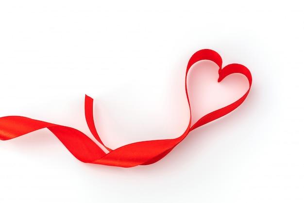 Valentine heart. red silk ribbon. love symbol .