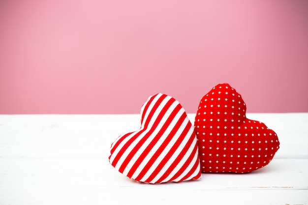 Valentine hearts on wooden background. minimal concept.