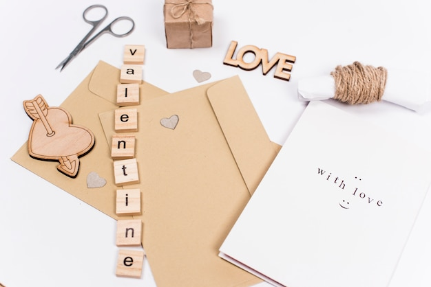 Valentine inscription with envelopes on table