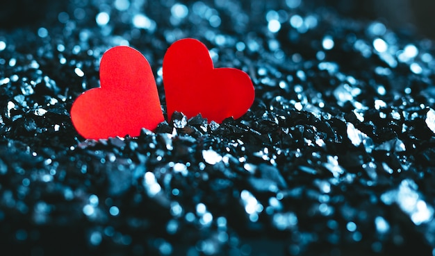 Valentine's concept. red heart on a blue background with bokeh.