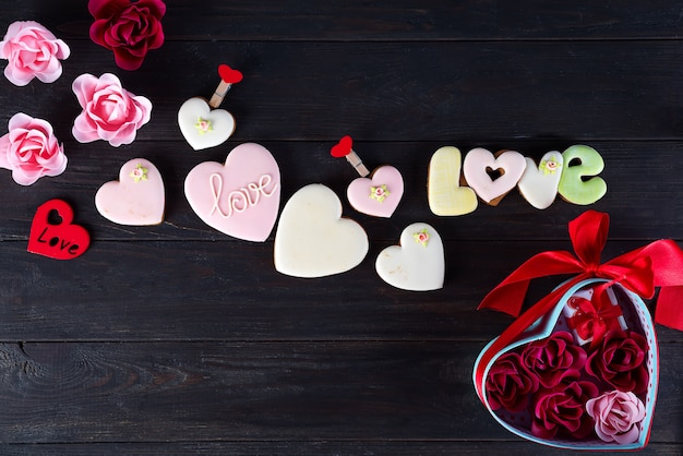 Valentine's cookies in shape of heart  on dark wooden background