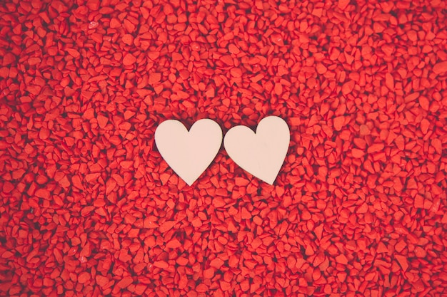 Valentine's day,14 february concetps.close-up two hearts on a red sand background.