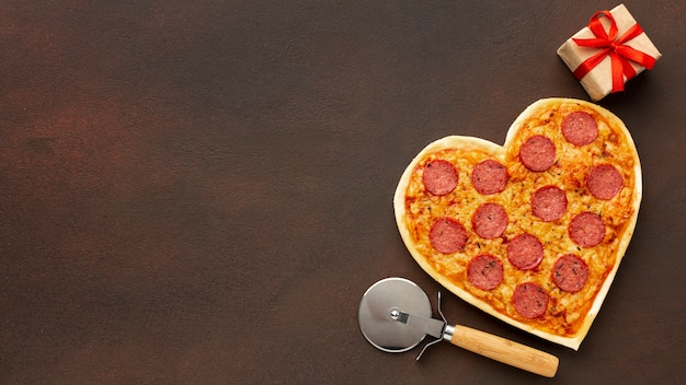 Valentine's day arrangement with heart shaped pizza and copy space