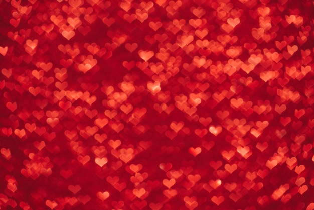 Valentine's day backdrop. red illuminated bokeh in the shape of hearts. abstract red background with blurred heart bokeh light.