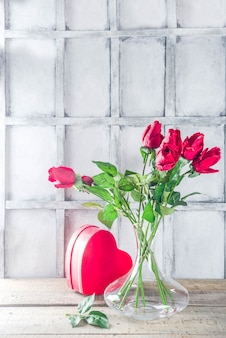 Valentine's day background card with gift box and rose flowers bouquet