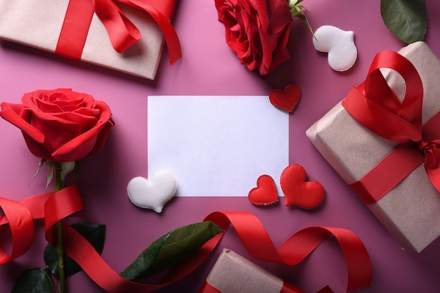 Valentine's day background greeting card love symbols , red decoration with glasses heart roses gifts on pink background. top view with copy space and text.flat lay